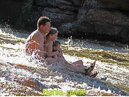 Family fun at the Ribeirão do Meio Waterfalls near Lençois, the best views while visiting Chapada Diamantiana national park, trekkings and walks while visiting Brazil's Chapada Diamantiana national park / Ivan Bahia Guide, traveling in Brazil, #IvanBahiaGuide #SalvadorBahiaBrazil #BrazilEssential #ChapadaDiamantina #ToursByLocals #GayTravelBrazil #IBG #FotosBahia #BahiaTourism #BahiaTravel #FotosChapadaDiamantina #fernandobingretourguide #BrazilTravel #ChapadaDiamantinaGuide #ChapadaDiamantinaTrekking #Chapadaadventure #BahiaMetisse #BahiaGuide #diamantinamountains #DiamondMountains #ValedoPati #PatyValley #ValeCapao #Bahia #Lençois #MorroPaiInacio (ref. Brazilian Grand Canyon)